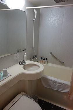 Minimal_Toilet_Shower_Bath_module_in_the_Japanese_hotel_room.jpg